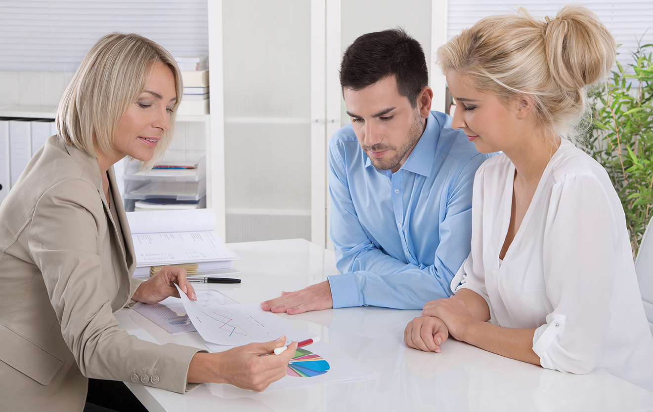 A couple discusses their finacnial situation with an advisor